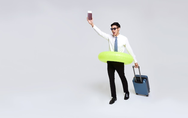 Happy asian businessman with passport and luggage enjoying their summer vacation getaway.