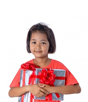 Happy asian child holding christmas presents. christmas or happy newyear time