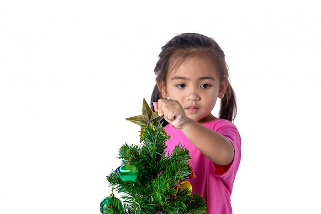Happy asian child holding gold star for decoration christmas tree.