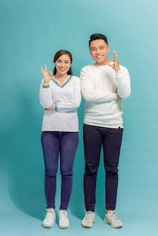 Happy asian couple love excited smiling with ok hand gesture