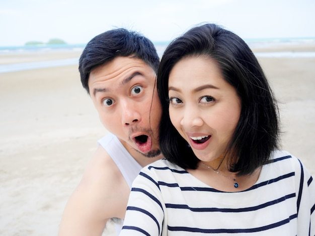 Happy asian couple lover on summer beach vacation
