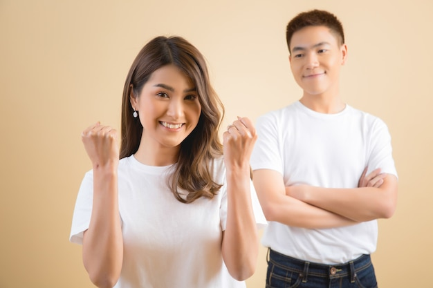 Happy asian couple in studio