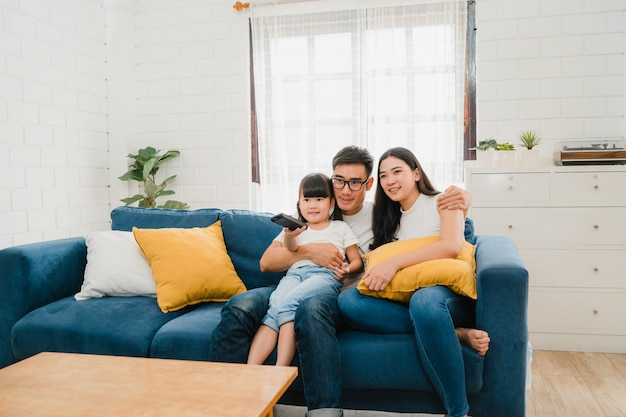 Happy asian family enjoy their free time relax together at home