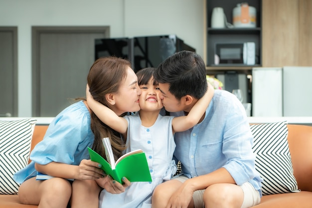 Happy asian family at home reading