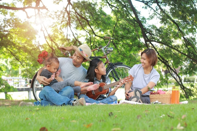 Happy asian family picnic togetherness relaxation concept