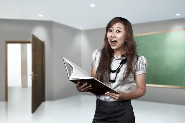 Happy asian female teacher ready to teach