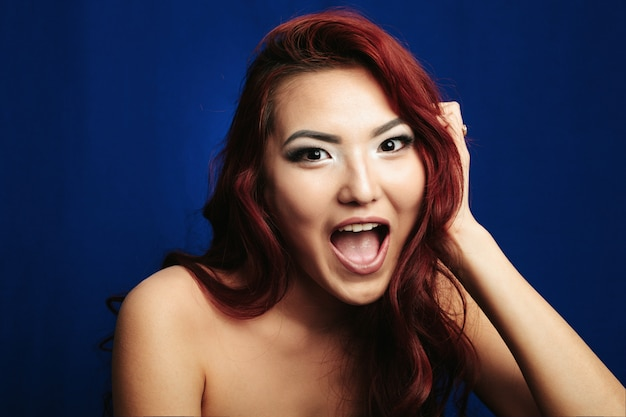 Happy asian girl on blue