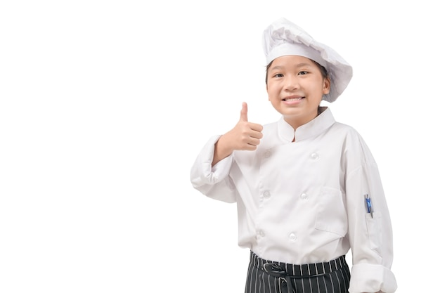 白い壁、コピー領域に分離された親指を均一を示す幸せなアジアの女の子シェフ