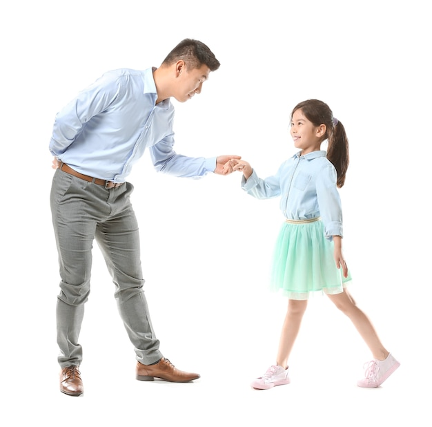 Happy asian man dancing with his little daughter