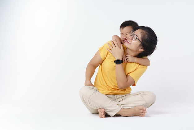 Happy asian mother and her son