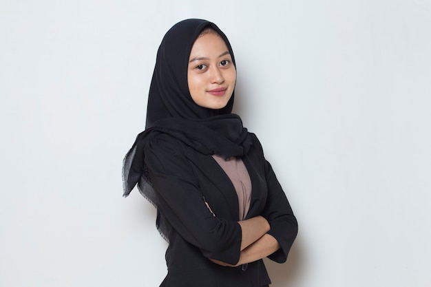Happy asian muslim woman in head scarf smile with arms crossed