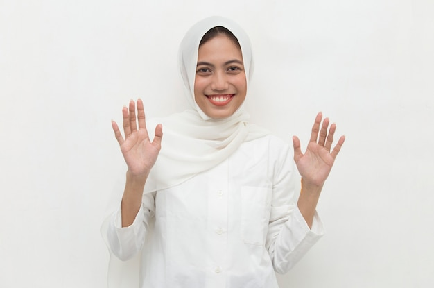 Happy asian muslim woman in hijab say hello