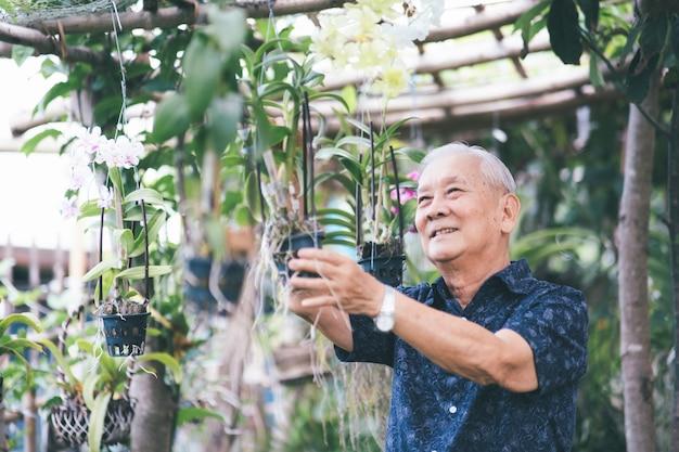 Happy asian senior man in his garden. happy retirement age.