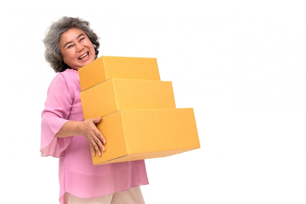 Happy asian senior woman holding package parcel box
