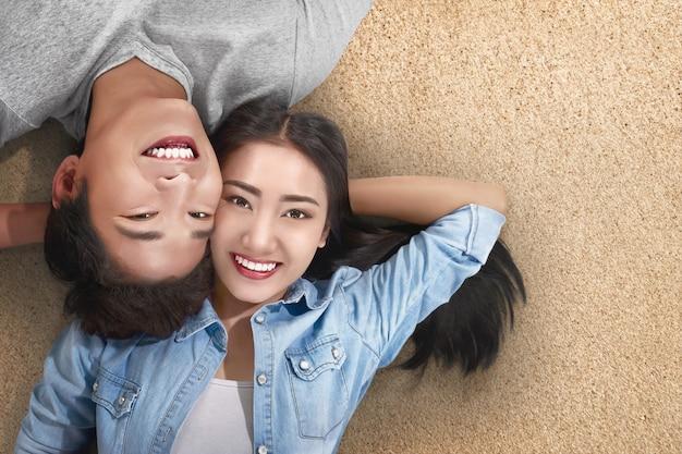 Happy asian traveler couple relaxing