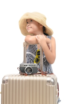 Happy asian traveler with baggage isolated