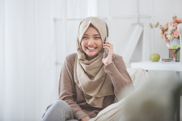 Happy asian woman calling with mobile phone