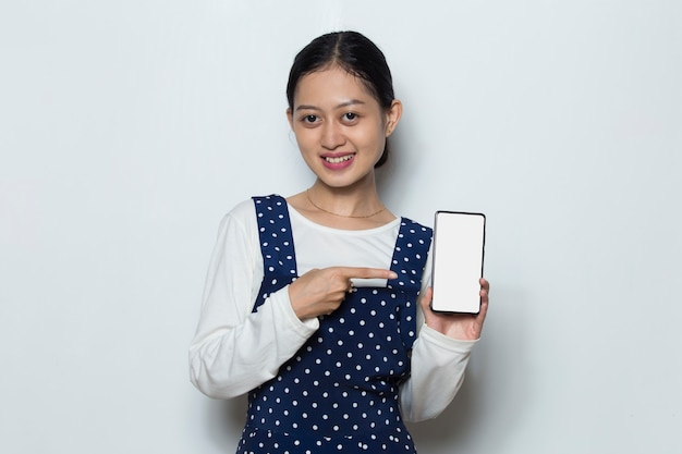 Happy asian woman demonstrating mobile cell phone