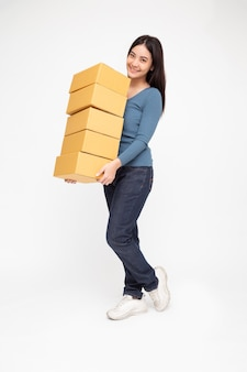 Happy asian woman holding package parcel box isolated on white background
