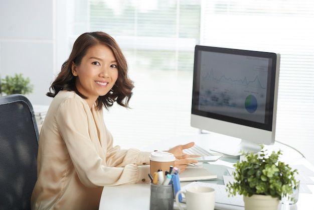 Happy asian woman at office