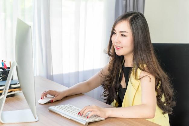 Happy asian woman in office