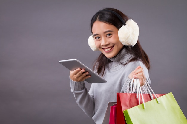 Happy asian woman shopping online