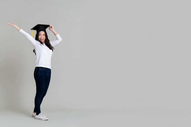 Happy asian woman smiling and wearing graduated cap