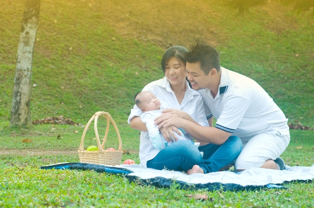 Happy asian young family spending time outdoor on a summer day