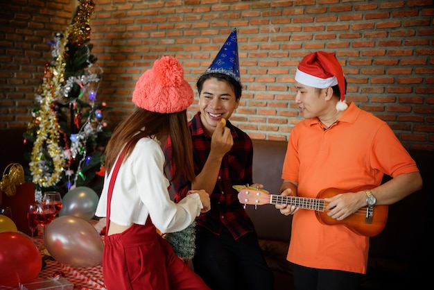 Happy asian young friends celebrate christmas party