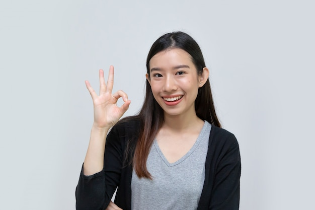 Happy asian young woman beautiful smile with ok gesture isolated