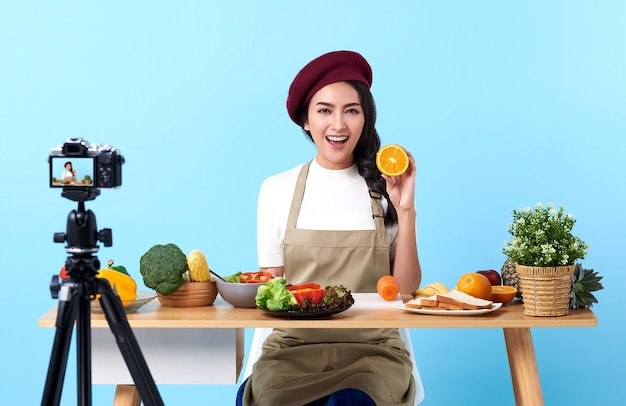 Happy asian young woman in fashion look style and shooting video