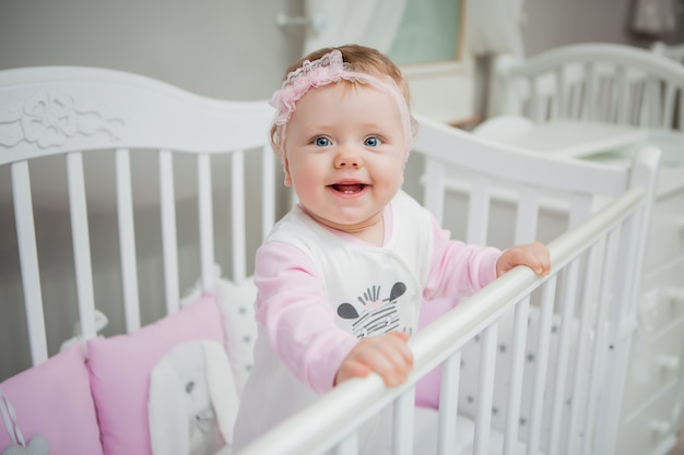 Happy baby on a bed at home