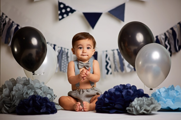 Happy baby boy celebrating first birthday