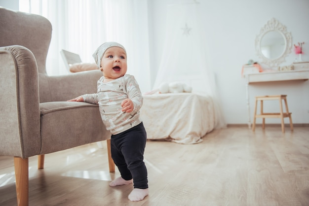 Happy baby chair next to a bright room