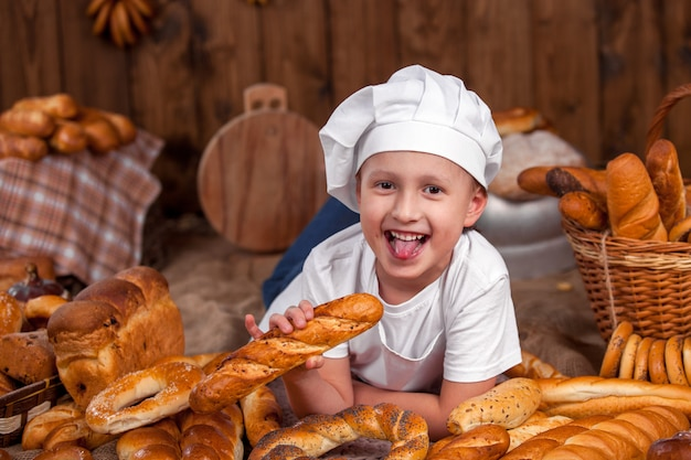 Happy baby chef is a baker wearing a lot of buns