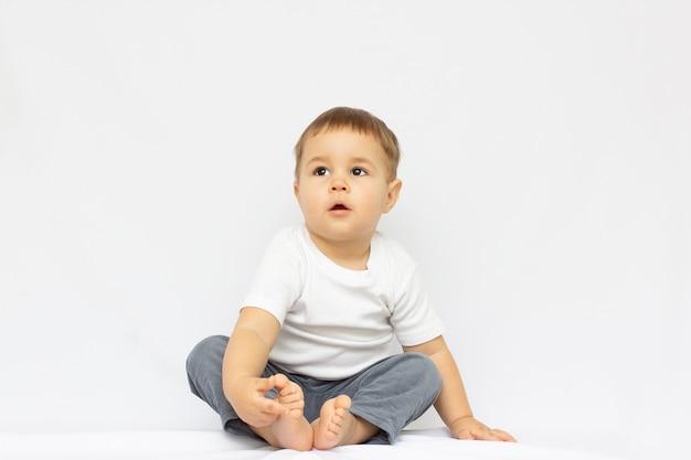 Happy baby. little boy in a white shirt and bow tie. children portrait. white background
