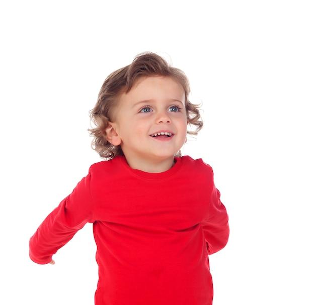 赤いtシャツを着て幸せな赤ちゃん