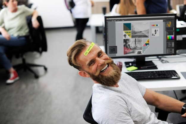 A happy beard man at office