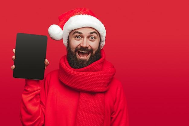 Happy bearded guy in santa hat