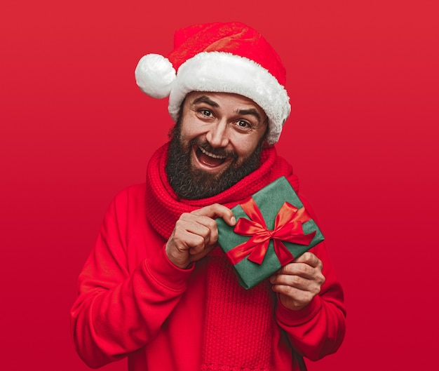 Happy bearded male hipster in santa hat