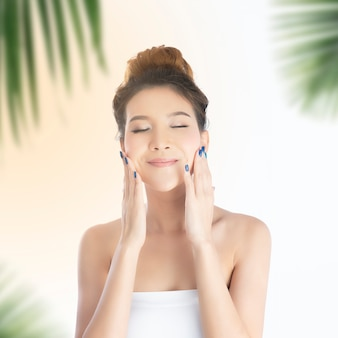 Happy beautiful asian girl with the fresh skin with sunlight background.