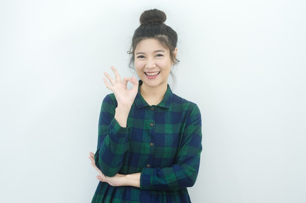 Happy beautiful asian woman show ok sign and smile