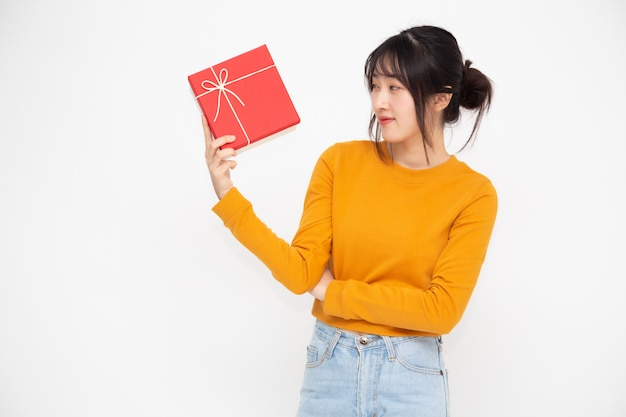 Happy beautiful asian woman smile with red gift box