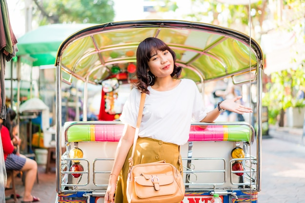 Happy and beautiful asian woman traveling at khao sarn road, thailand