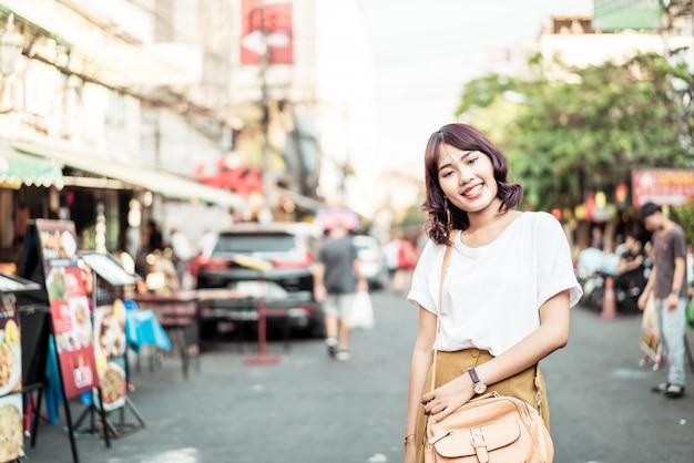Happy and beautiful asian woman traveling at khao sarn road, thailand