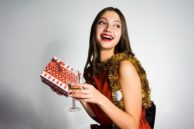 Happy beautiful girl received a gift for the new year 2018