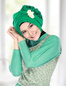 Happy beautiful muslim woman smiling