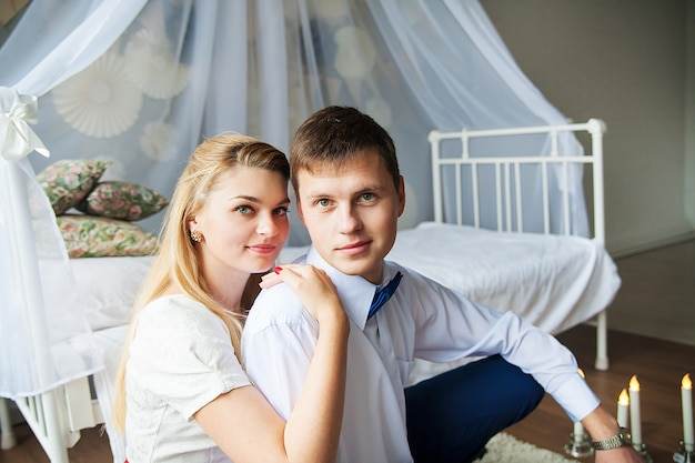 Happy and beautiful shooting of a young couple in a photo studio