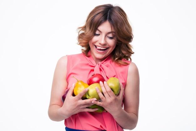 과일을 들고 행복 한 아름 다운 여자
