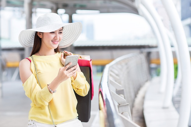 Happy beautiful young woman enjoy shopping with shopping bag and